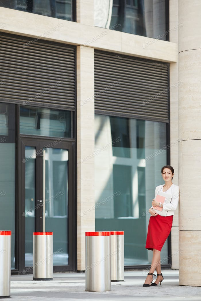Beautiful Businesswoman Posing by Office Building