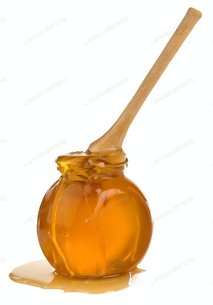 jar of honey isolated on white