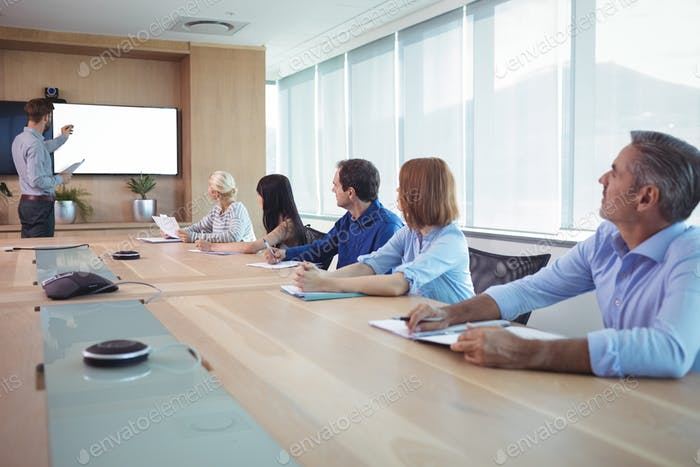 Business people at conference table during meeting
