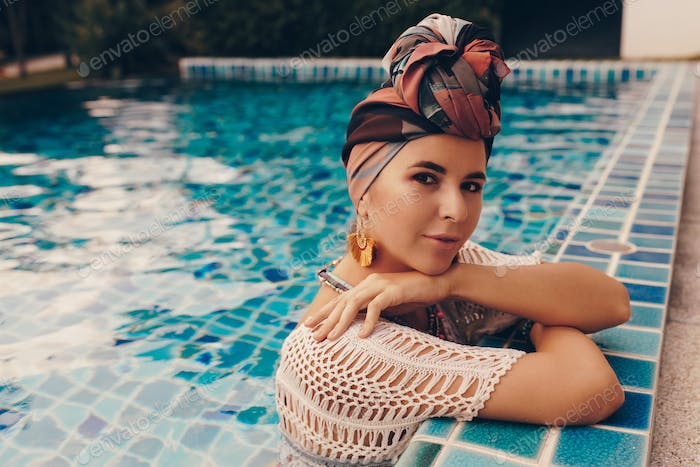 Close up portrait of confident woman demonstrate summer fashion trends