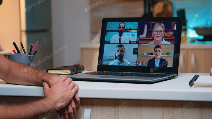 Remote employee having video conference working from home
