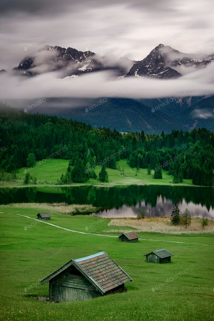 Geroldsee during rainy day with foggy clouds over mountain peaks, Bavarian Alps, Bavaria, Germany.