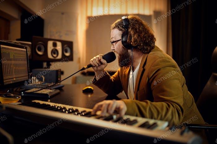 Sound engineer holds microphone, recording studio