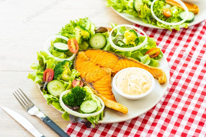 Grilled salmon meat steak with fresh vegetable