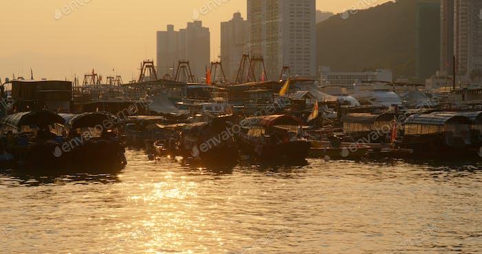 Aberdeen, Hong Kong 12 May 2019: Hong Kong harbor port in aberdeen at sunset time