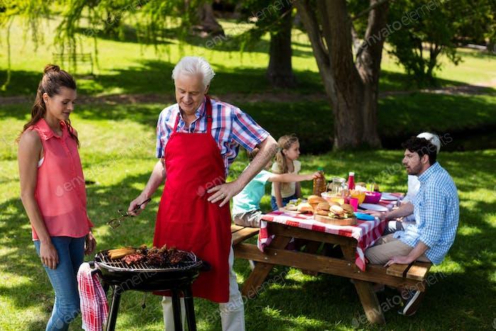 Family preparing barbeque