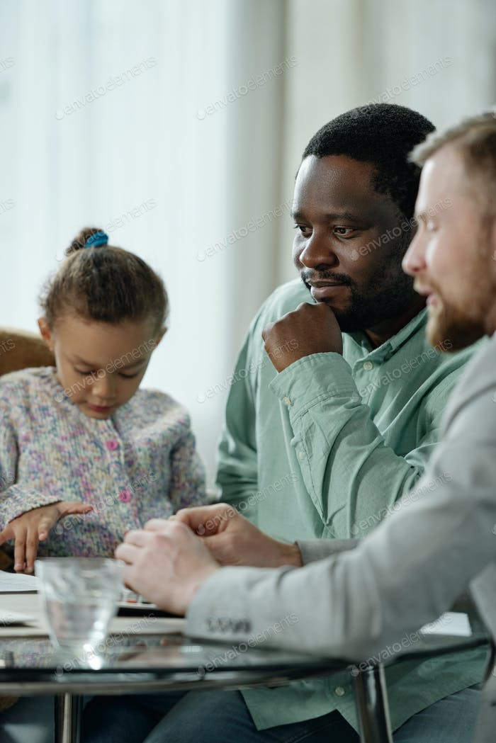 Black man with family listening to counselor