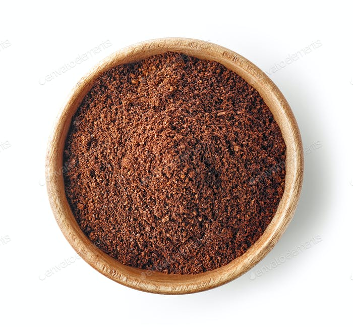 wooden bowl of ground coffee
