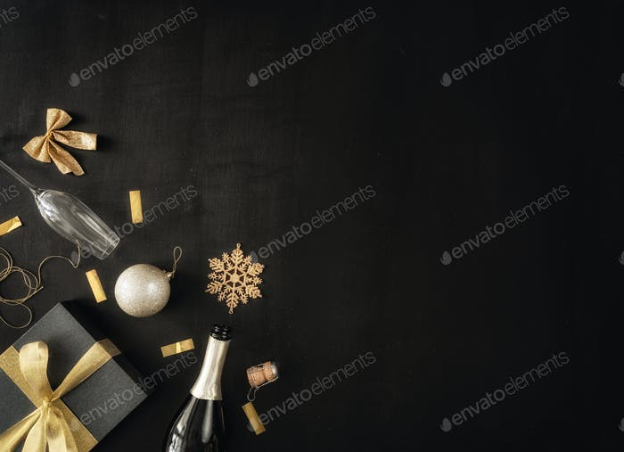Baubles and gifts on black desk