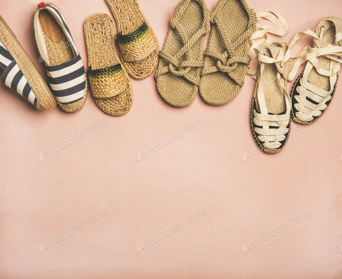 Variety of trendy summer shoes over pink background, copy space