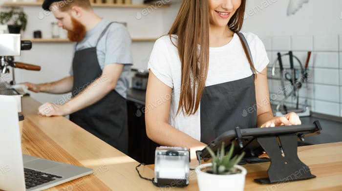 Coffee Business Concept - beautiful caucasian bartender barista or manager Posting order in digital