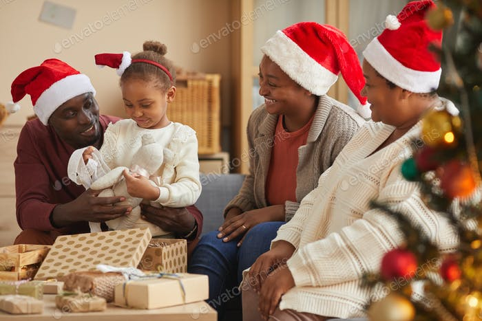 Happy African-American Family Celebrating Christmas Together