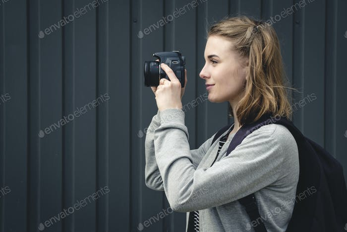 Young woman photographer lining up an image