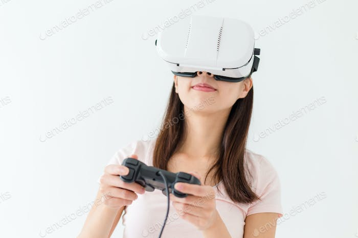 Woman play the video game with VR device
