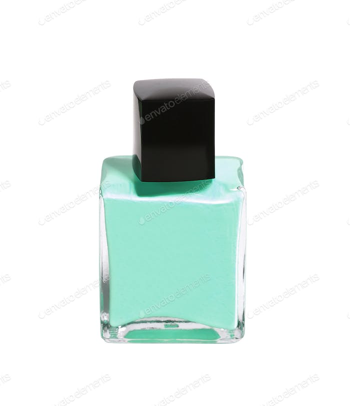 green nail polish bottle on white background