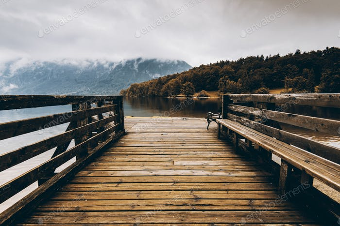 Wooden pier at autumn lake, fall colors