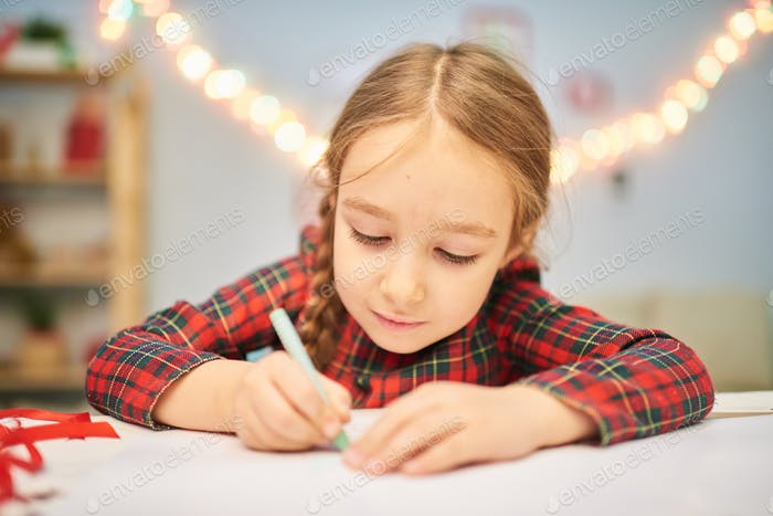 Focused on Drawing Christmas Card