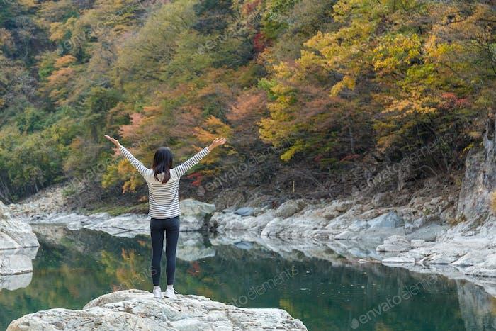 Woman feeling carefree at natural landscape