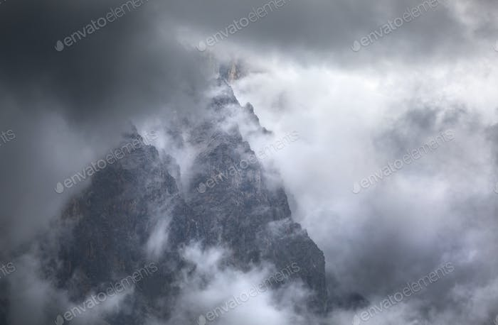 dramatic storm clouds around rocks