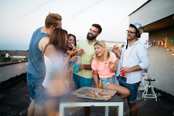 Friends and pizza. Young cheerful people eating pizza and having fun