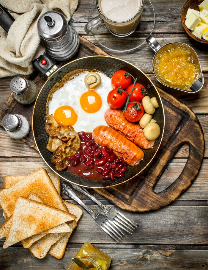 English breakfast.Fried eggs with sausages, fried bread and aromatic coffee.
