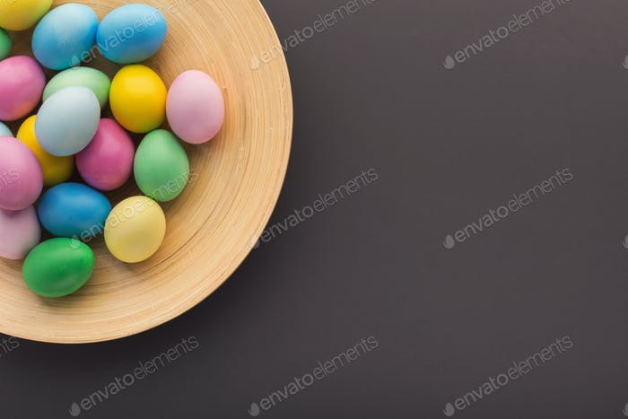 Easter background. Colored eggs on gray stone surface
