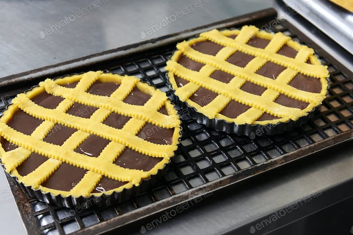 Two freshly baked chocolate cakes or tarts