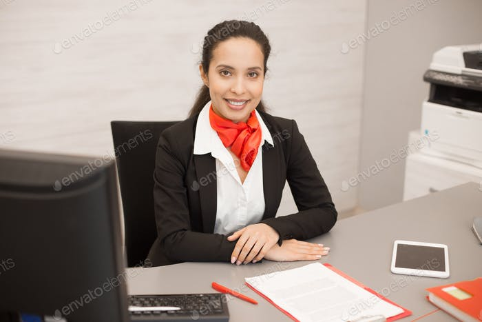 Latin Businesswoman at Desk