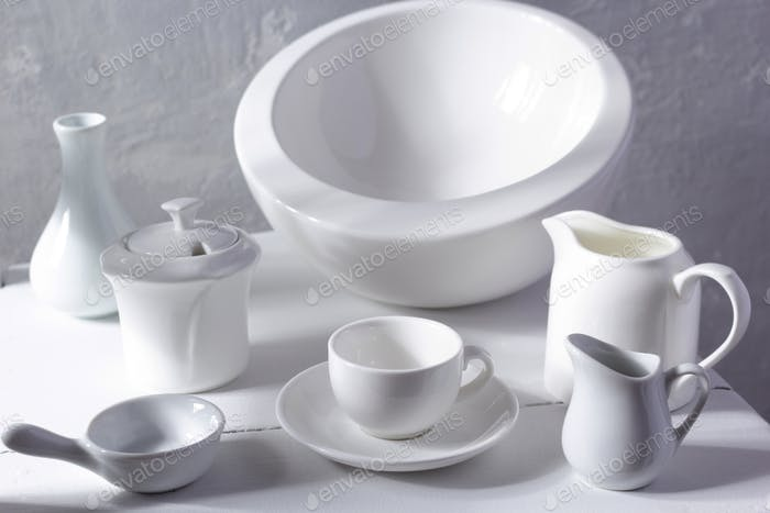 Empty crockery or ceramic dishes set. White kitchen dishware and tableware