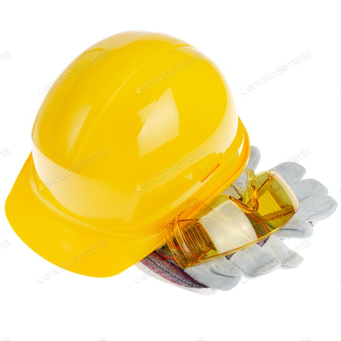 Yellow plastic hard hat glasses and protective gloves isolated on white background