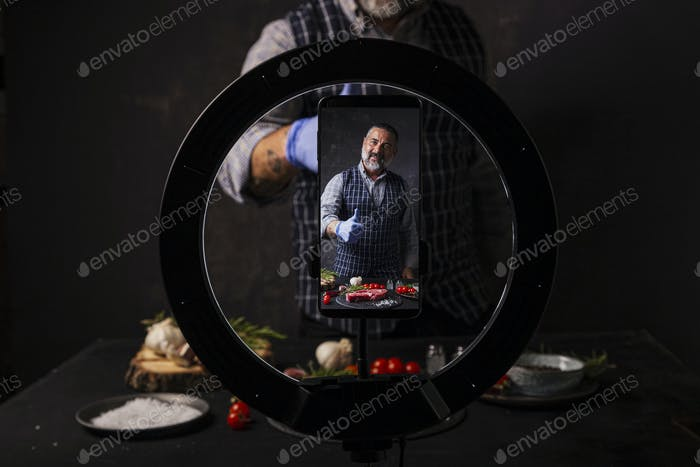 Man broadcasting a video blog about tasty and healthy food. Healthy lifestyle and social media