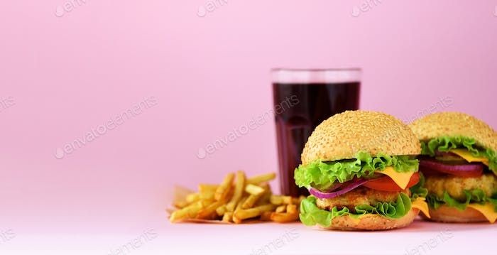 Fast food banner. Juicy meat burgers, french fries potatoes and cola drink on pink background. Take