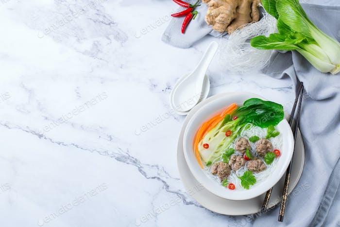 Asian bee hoon, bihun soup with pork balls, rice noodles
