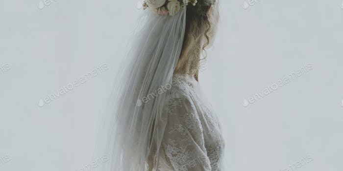 Woman in a wedding dress looking away
