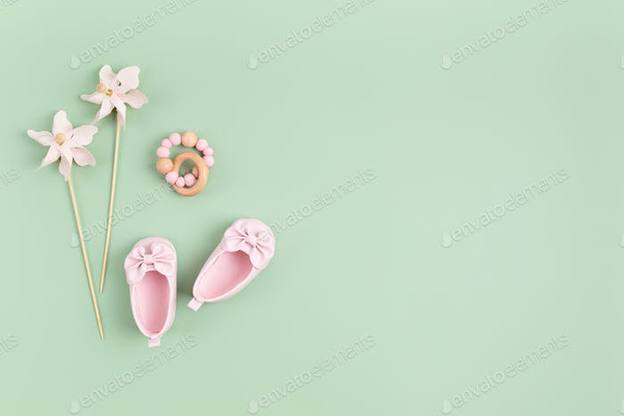 Baby shoes and teether. Baby shower invitation, greeting card