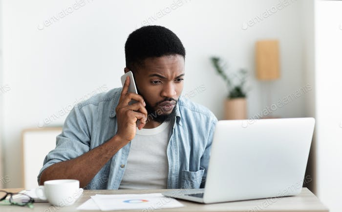 Millennial guy dialing technical support cause his internet is down