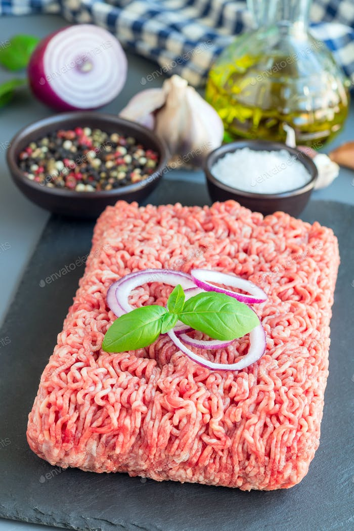 Minced meat from pork and beef. Ground meat with ingredients for