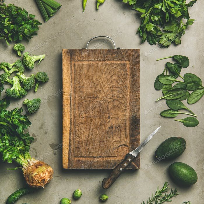 Healthy vegan ingredients and wooden board in center, square crop