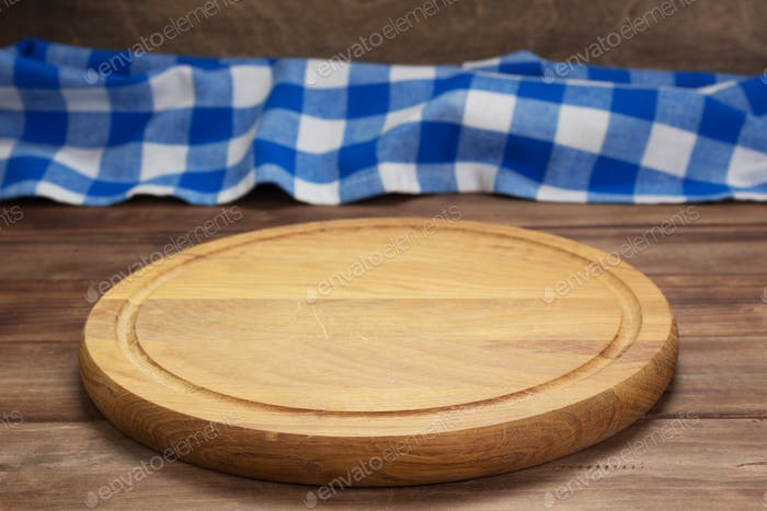 pizza cutting board and napkin tablecloth at wooden table