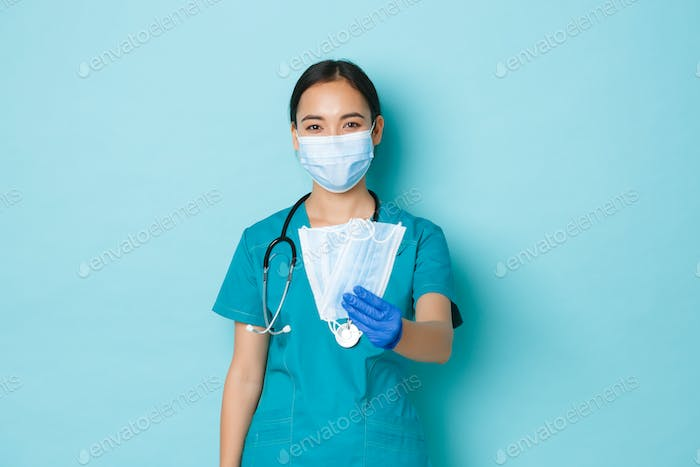 Covid-19, social distancing and coronavirus pandemic concept. Friendly cute asian female doctor
