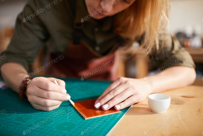 Woman doing Leatherwork Closeup