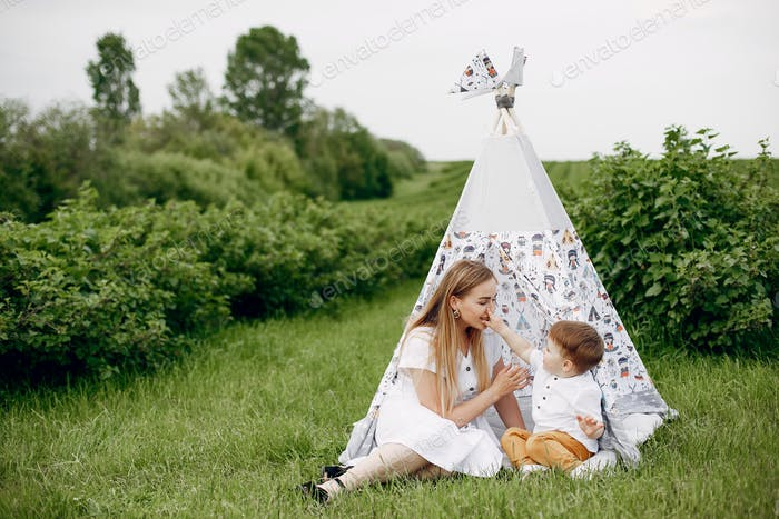 Mother with sonplaying in a summer field