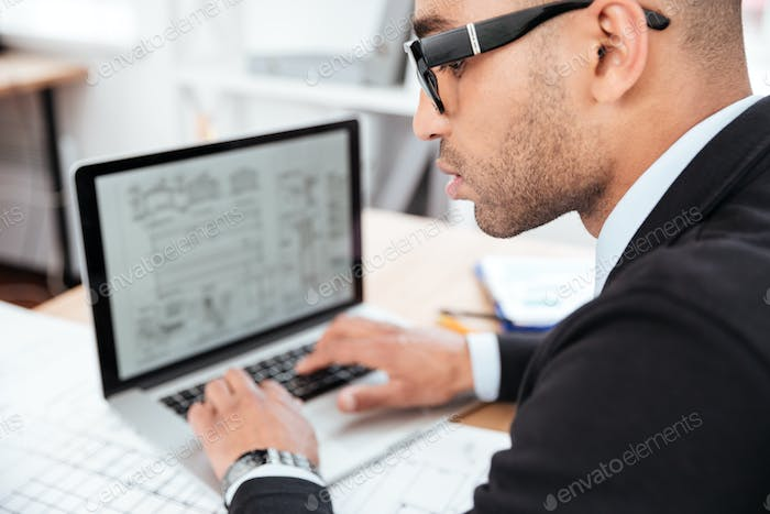 Close-up portrait of a pensive businessman in office