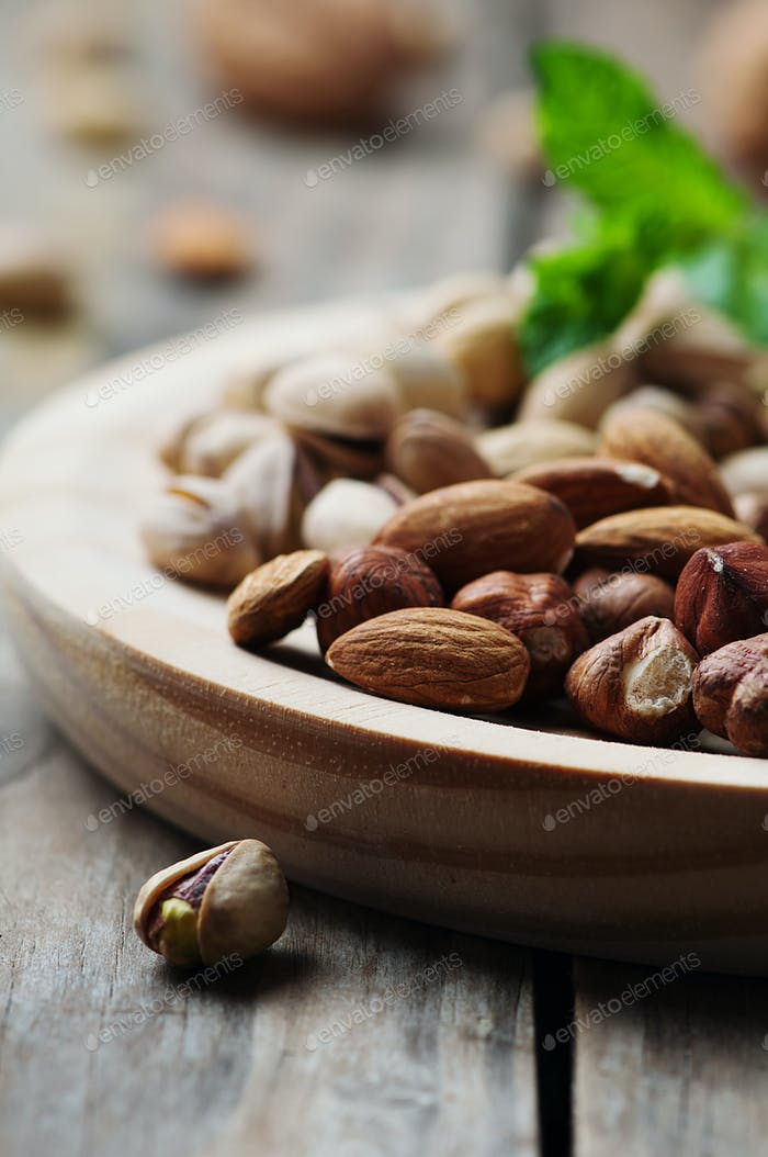 Mix of nuts on the wooden table