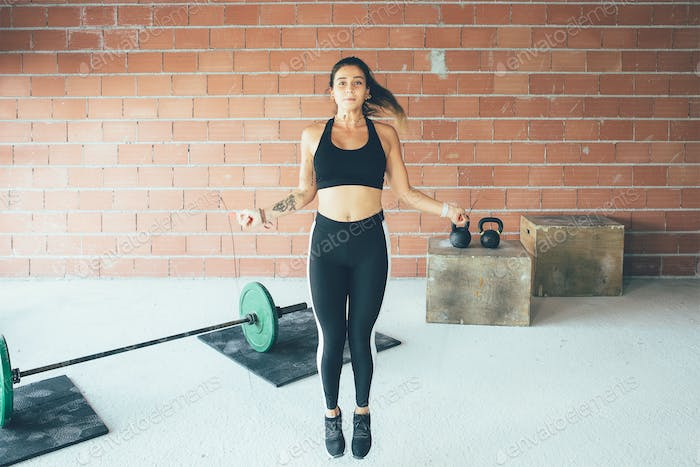 Fitness_woman_doing_jumping_rope_exercise