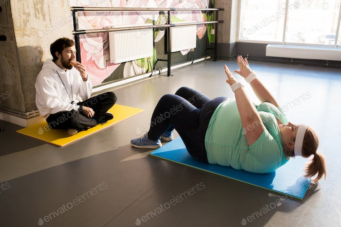Obese Woman Working Out on Floor