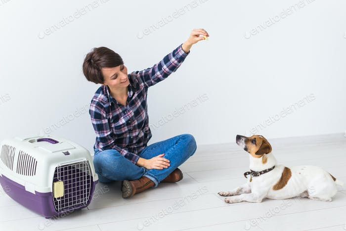 Female in plaid shirt holds favourite pet