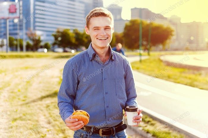 Man bites freelancer sandwich with coffee