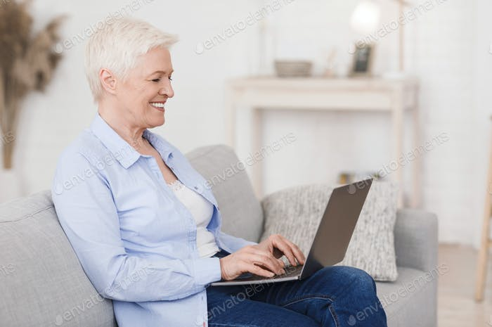 Dating Sites For Seniors. Portrait of elderly lady with laptop at home