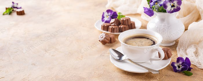 Cup of coffee with chocolate candies